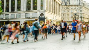Stock image of shoppers on a busy street